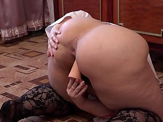 A fat girl in red thongs masturbates her hairy pussy with a dildo.