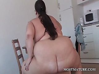 Mature BBW works her tits with a dildo