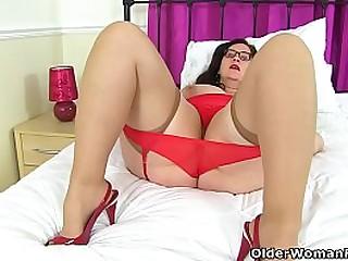 English BBW milf Jayne Storm is up to no good in her red lingerie and sheer stockings. Bonus video: UK BBW milf Sarah Jane.