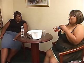 Hot black BBW sluts get their twats drilled by dildo on the couch