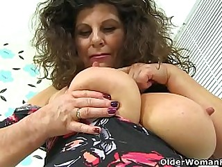 Big titted milf Gilly from the UK lowers her knickers and pumps her pink fanny with a dildo. Bonus video: British milf Jessica Jay.